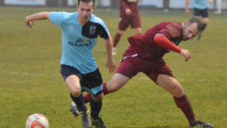 Reece King in action for Godmanchester Rovers in their defeat to Kirkley & Pakefield.