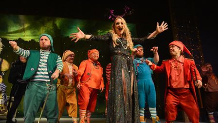 EastEnders star Rita Simons as the Wicked Queen with the Seven Dwarfs in St Albans pantomime Snow Wh