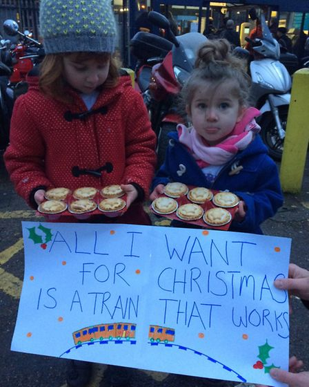 Youngsters Phoebe and Margo Bortone make their point, calling upon GTR to improve Thameslink service