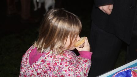 A young spectator enjoying a mince pie. Picture: Alex Pinzon