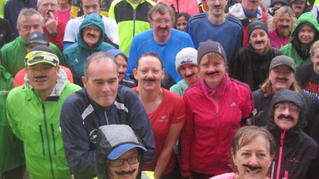 Wimpole parkrunners get into the Movember spirit.