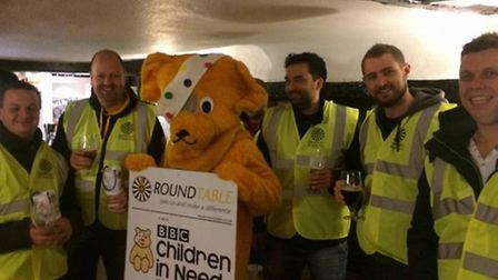 St Neots Round Table members with Pudsey, collecting for Children in Need.