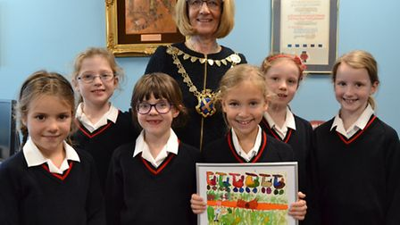 Christmas card comp winner Molly with her friends and Mayor