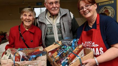 Community Champion Aylce Barber gives Iris and Dennis Wiles their hampers.