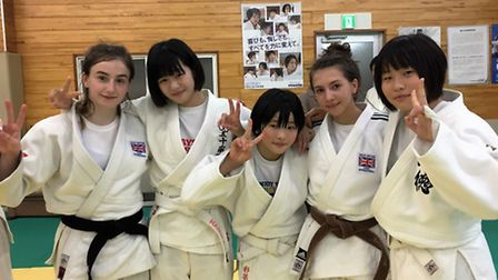 Amy Platten and Yasmin Javadian with Japanese judoka during the Tokyo camp