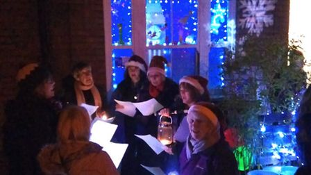 The festivities began outside the first Living Advent window on Ladysmith Road