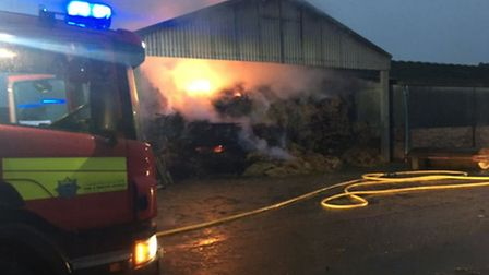 Overnight fire crews have been tackling a large barn fire in Sawtry