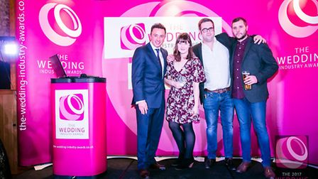 Elizabeth Hall Event Design's team receiving their Caterer of the Year award