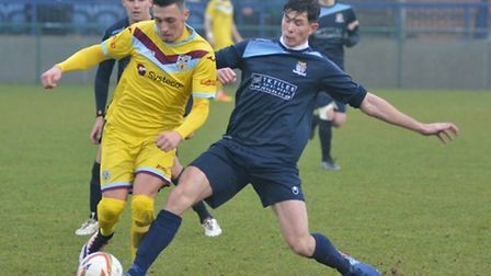 Taylor Parr makes a challenge during St Neots Town's 4-0 loss to Weymouth.