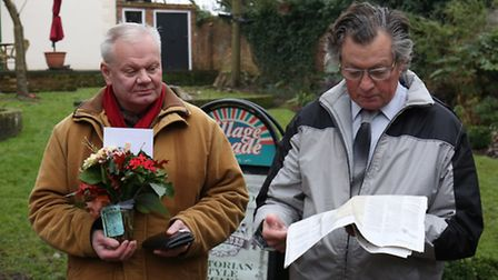 Members of the St Albans civic society Eric Roberts and Bryan Hanlon lay some flowers at the foot of