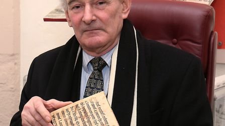 St Albans School archivist Nigel Woodsmith with the school's oldest printed text book which has been