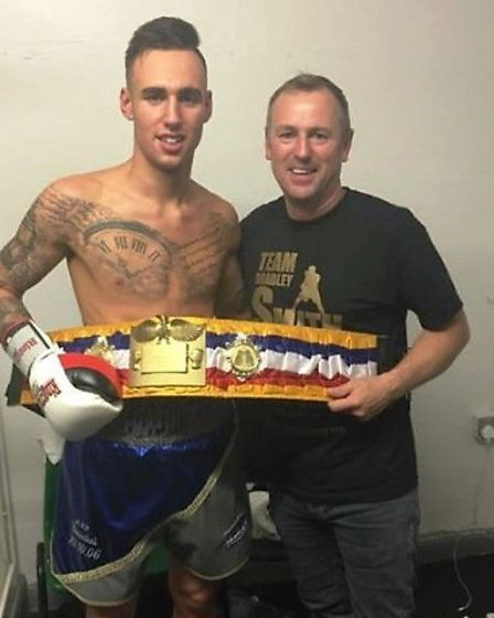 Top boxing prospect Bradley Smith shows off his International Challenge title with father, Andy.