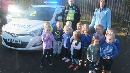 PCSO James Lynch with staff member Hannah Richardson and children from LItlington Preschool.