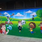 The finished mural which depicts the activities that take place in the recreation ground