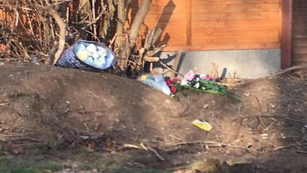 Floral tributes have begun to be placed at the scene of the crash at the Old North Road roundabout i