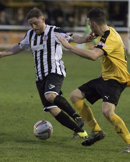 Ben Seymour-Shove on the ball for St Ives Town in their 2-0 loss at Southern League Premier Division