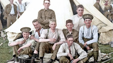 Territorials of the Hertfordshire Regiment at lunch. Credit: Colourised by Doug Banks of Colourisin