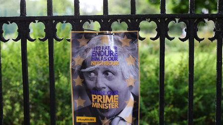 A poster a gate opposite the south London home of Conservative party leadership candidate Boris John