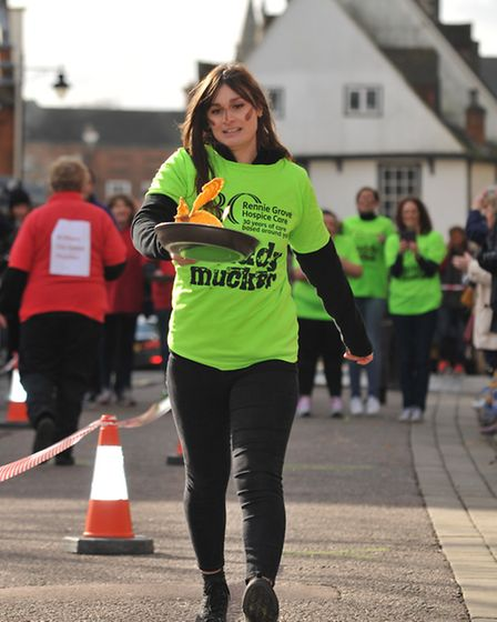 A contestant in the 2016 St Albans pancake race
