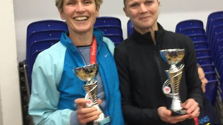 Penny Hibbick, left, and Wendy Walsh collect their trophies at the Buntingford 10-mile race