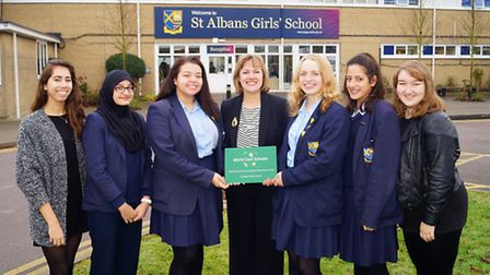 Head Margaret Chapman with girls in the quality mark team