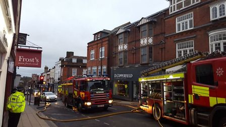Firefighters tackling the blaze at the Oxfam charity store in Chequer Street, St Albans. Photo court