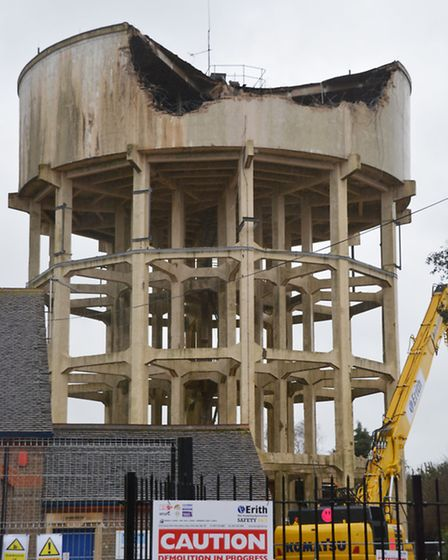 Water tower which is in the process of being demolished