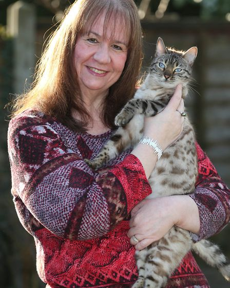 Maxine Crawley, with her cat Anoushka, has lost 8 stone in about a year.