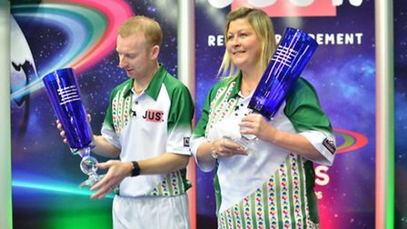 Nicky Brett and partner Claire Johnston show off their World Indoor Championships mixed pairs trophi