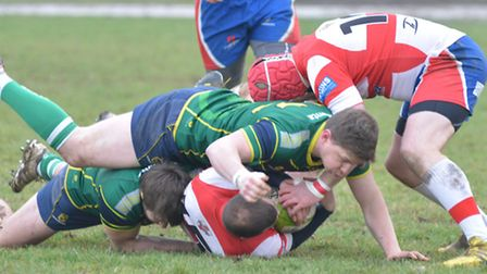 It's a Stags sandwich as Tad Chapman (top) and Barnie West (bottom) go into a tackle against Welling