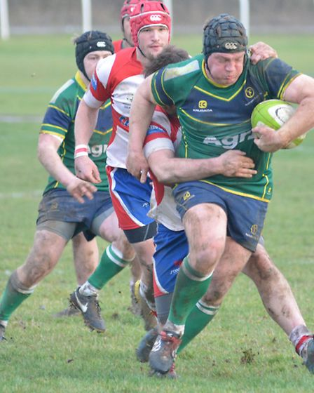 James Thorp on the charge for Huntingdon against Wellingborough.