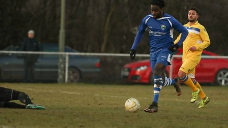 Dave Parkinson goes round Graham Loki in the Broxbourne goal to make it 3-0. Picture: MARK LONG