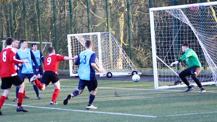 Jake Peattie (9) scores for AFC Barley Mow in their win against Wimblington. Picture: MARTIN WRAY