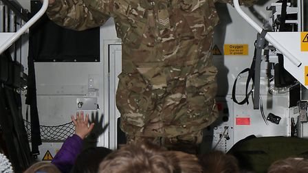 Sgt Patrick Slaney shows Garden Fields year 4 pupils the field ambulance used by the army.