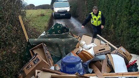Fly tipping on Gibraltar Lane, with police officers in attendance. Credit: Harpenden Police