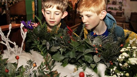 Jack and Dillon Richards with the Land of Narnia created by Pat Ames. Picture: Clive Porter