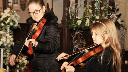 Music provided by 10-year-old Niamh Roberts and mum Caroline. Picture: Clive Porter