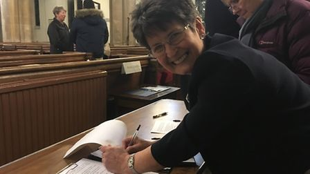 Maggie Allen signs the petition.