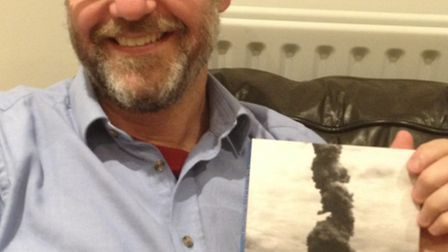 David Marlow of 47 Brampton Road, St Albans, posing with his book Fire in the Whole