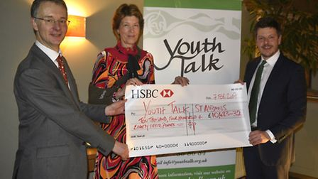 Chief Executive of Youth Talk, Trevor Fromant (left), and Lady Verulam (centre) receiving a cheque f