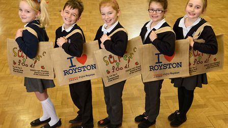 Evie O'Connor, eight, Tannery Drift First School in Royston, with her winning bag design and her fri