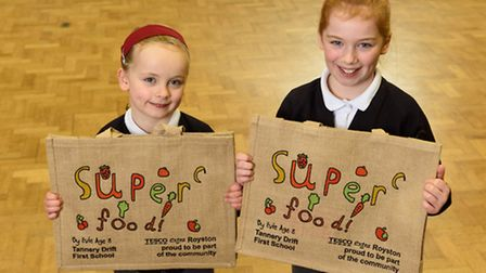 Evie O'Connor, eight, Tannery Drift First School in Royston, with her winning Tesco bag for life des