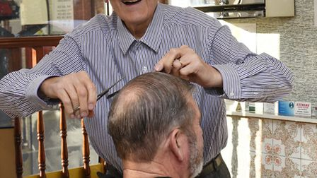 Jimmy Mosca has been cutting hair in St Neots for 50 years.