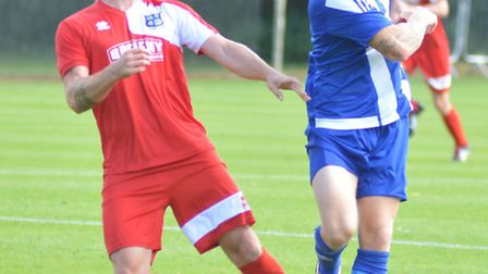Steve Hurst (left), playing as a defender earlier in the season, provied to be an inspired goalkeepi