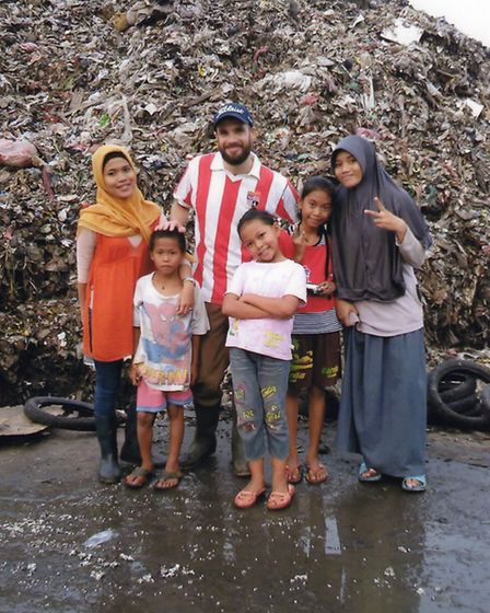 John Devlin with youngsters at the landfill site