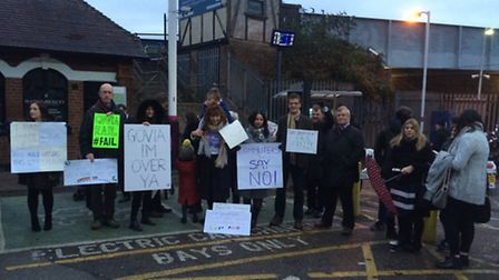 The protest outside St Albans City station, organised by the Train Suffererjettes