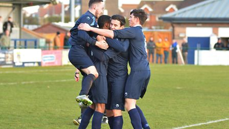 St Neots Town players celebrate Jevani Brown's opening goal in their defeat against Hitchin.