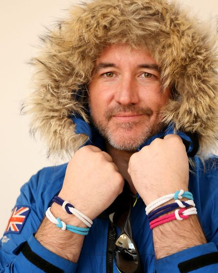 Rob Smith wearing Cancer Research UK unity bands.