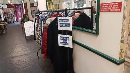 A charity coat rack set up by Sharon Minkin. Photo was taken outside Village Barbers, in the Village