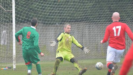 Dennis Squires scores in his farewell appearance for Huntingdon United Reserves against Marchester U